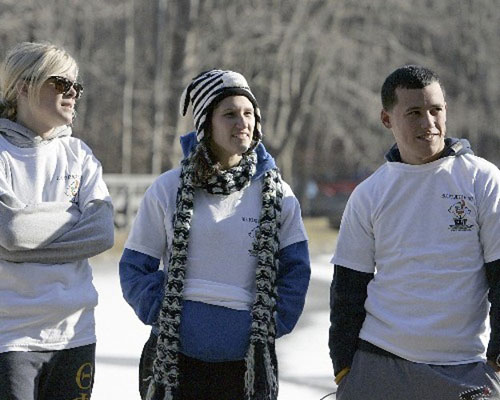 Board member, Nikki Collins with 2 plungers, Amanda & Rich, outside before the plunge.