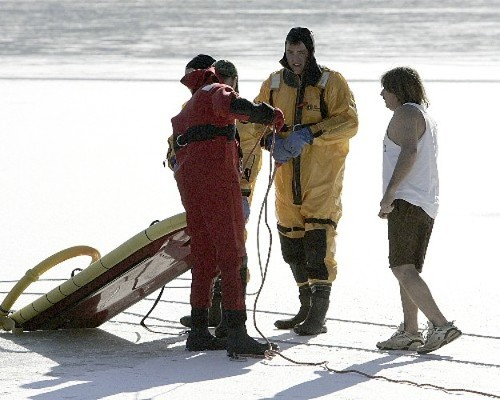James Lanera with water rescue team on the ice, minutes before the plunge.