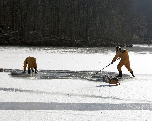 Grooming the area of the ice to be cut.