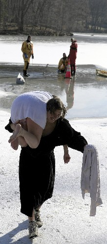 James carrying his daughter, Jaymie, to warm her frozen toes.