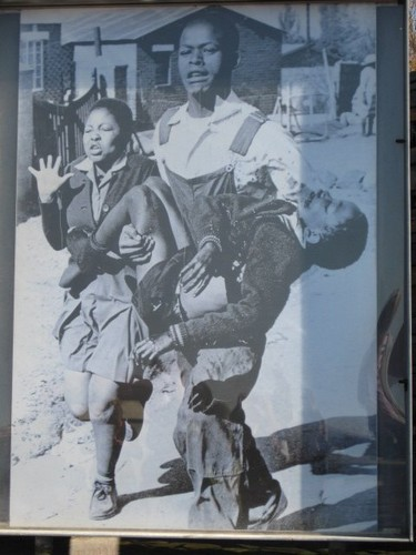 Picutre of Mbuyiswa carrying injured Hector Pieterson in his arms, during the Soweto student uprising of 1976.