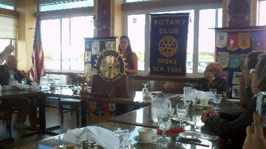 Jaymie speaking in front of the Bronx Rotary Club.