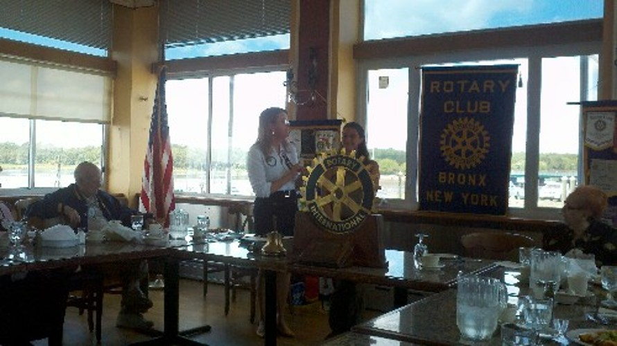 Jaymie being awarded a pin from the President of the Bronx Rotary Club.
