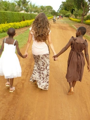 Walking home from the orphanage with Katherine (left) and Sharifa (right). Katherine and Sharifa are 2 of the 15 family members that Jaymie lived with.