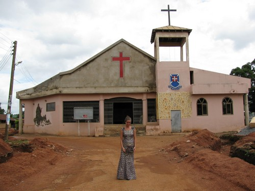 Jaymie in front of the Abokobi Presbyterian Church in her Sunday dress.