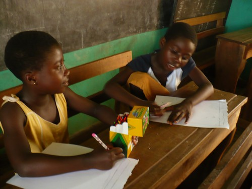 Elizabeth(class 3) & Augustina(class 2) coloring and writing.