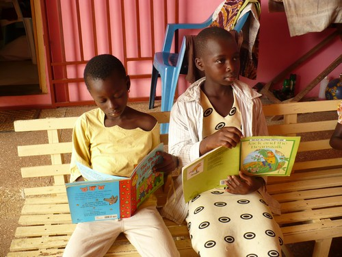 Yvonne (class 2) & Mary (class 5) reading and being concept checked about what they are reading.