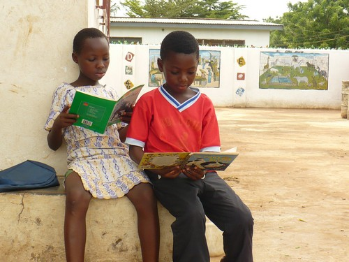Mary & Jonathan (class 2) helping eachother read their books.