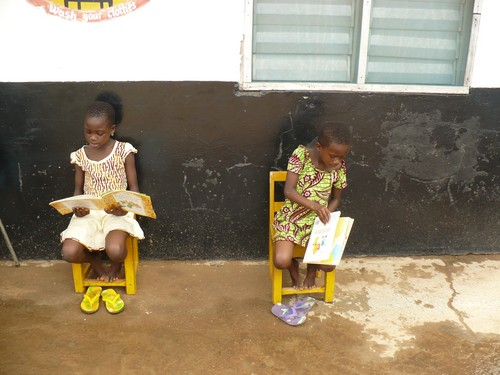 Naomi (class 3) & Comfort (class1) reading silently.